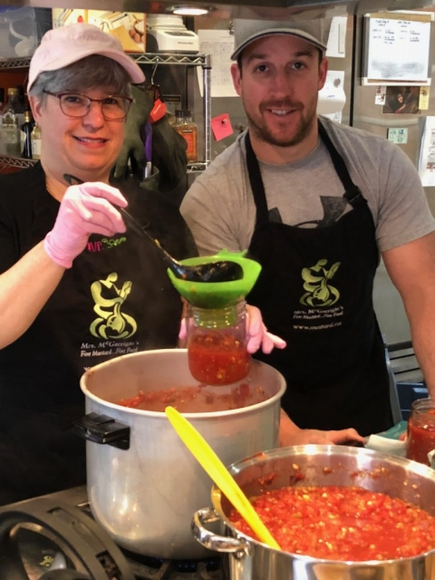 IMAGE: (Almost) The final step: Mom and Dave jarring the almost-ready-to-eat salsa. The final step, of course, is when you open a jar and share with friends and family...